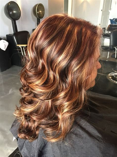 Brunette Hairstyle With Lots Of Hilights For Over 50 | dark brown hair with lots of blonde highlights wave hair