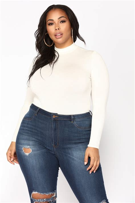 plus size african american ladie with one inch hairstyle plus bodysuits