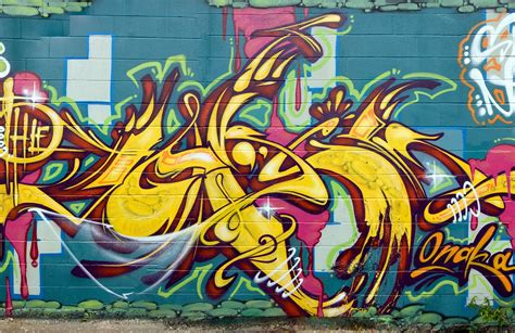 blue  yellow graffiti wall mural muralswallpapercouk