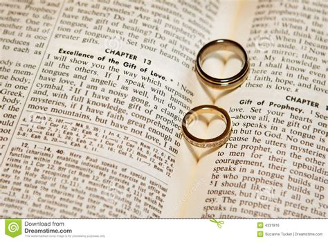 wedding bands with bible verses wedding rings on a bible stock photo image of diamonds
