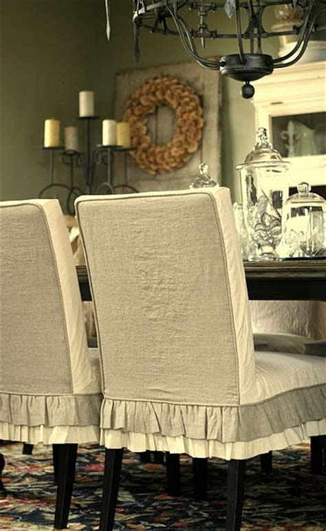 fabric covered dining room chairs i m not usually a fabric covered dining room chair of person but i like these slipcovers