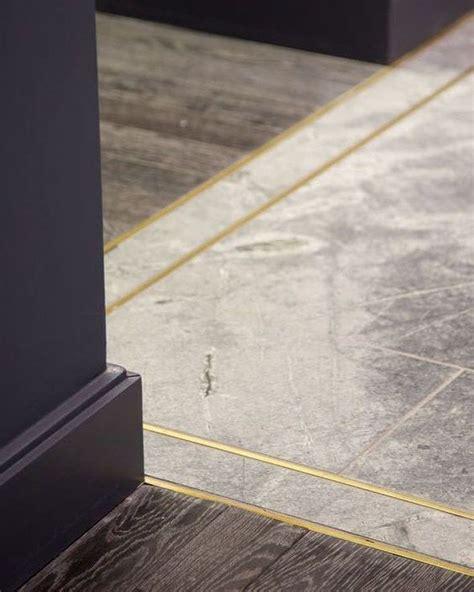 strips  goldbrass trim  hardwood  tile