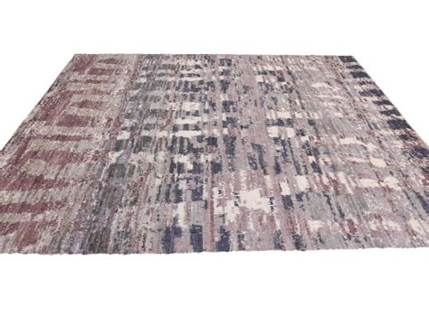 moroccan style rug with abstract design for