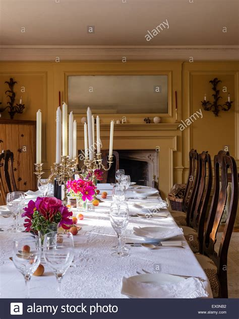 Cloth Dining Chairs Candelabra On Dining Table With White Cotton Tablecloth