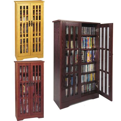 Storage Cabinet Glass Doors Leslie Dame Cd Storage Cabinet With Glass Doors Oak Walnut Or Cherry M 371