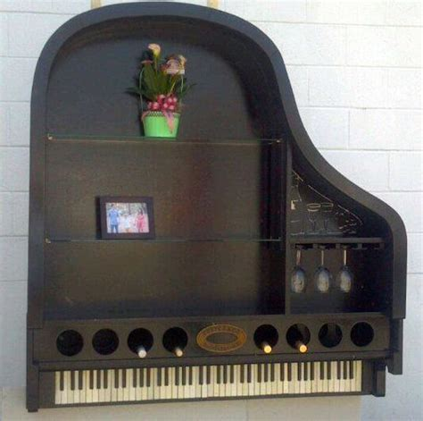 repurposed piano makes a grand bookcase wine rack