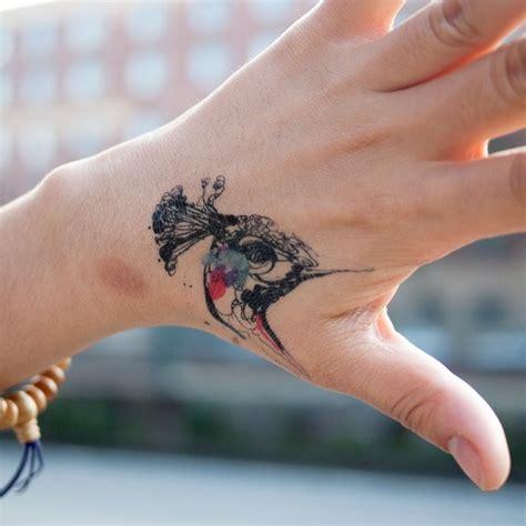 tattoo hand bird 35 exquisite hand tattoo designs