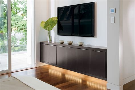 Floating Storage Cabinets Reinvent The Media Room With Cabinetry