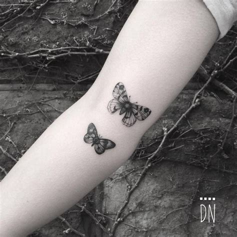 couple line tattoo fine line butterfly couple on the right inner arm done at