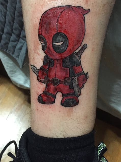 deadpool tattoo baby deadpool on leg by shane wasserman