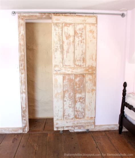 How To Make A Rolling Barn Door Remodelaholic Diy Sliding Barn Door Inexpensive Hardware