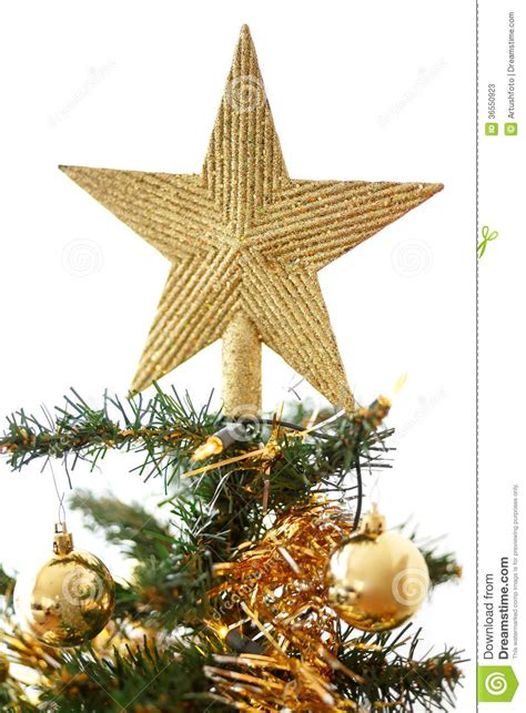 decorated christmas tree with yellow and green balls stock