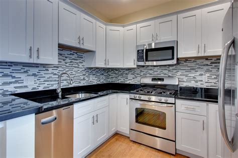 white cabinets white countertop kitchens with black countertops and brown cabinets