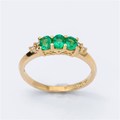 oval emerald tree ring and accent 14 karat