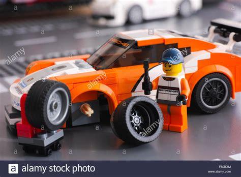 Wheels Porsche 911 Gt3 Rs Merah Miniature Mobil Hotwheels lego driver minifigure is fixing wheel of porsche 911 gt by lego stock photo royalty free image