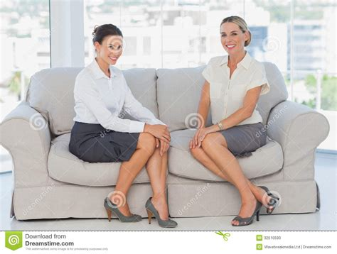 sitting on the couch business women sitting on the couch stock photo image