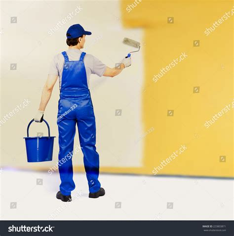 how to become a professional house painter back view house painter painting yellow stock photo 223803871 shutterstock