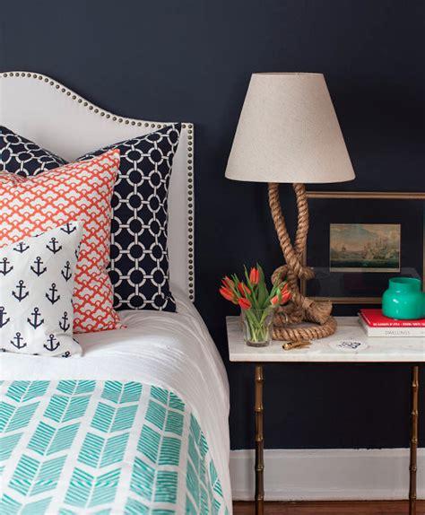 navy blue and orange bedroom design fixation navy blue bedrooms with pops of orange