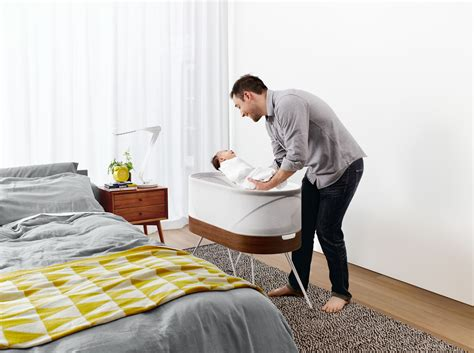 baby bed that connects to parents bed smart crib rocks your baby back to sleep design milk