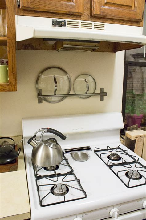 kitchen towel bars ideas 15 storage and organization ideas for your kitchen use a towel bar to store pot lids 1