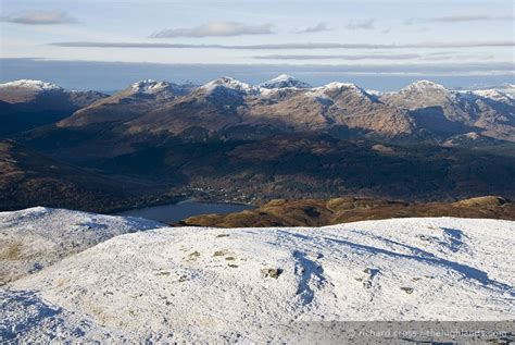 arrochar with ben lomond behind taken from the path to the cobbler arrochar alps from ben lomond the scottish highlands