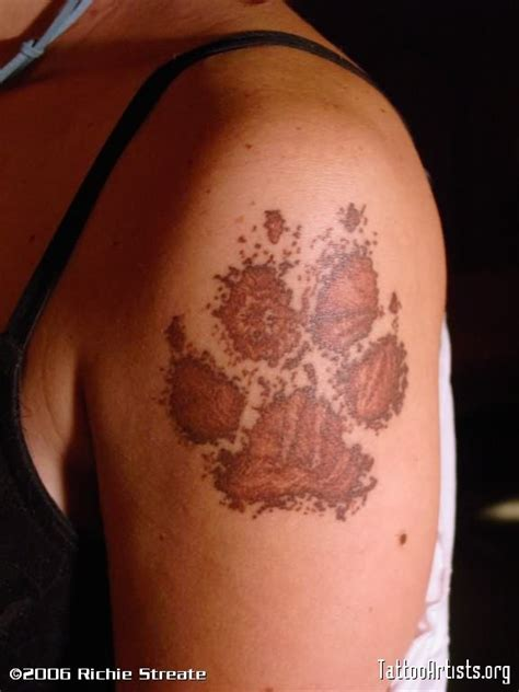 wolf paw print tattoo wolf in paw print
