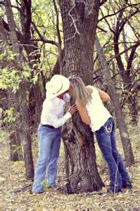 this would be cute without the kissing maybe standing on either side of the tree