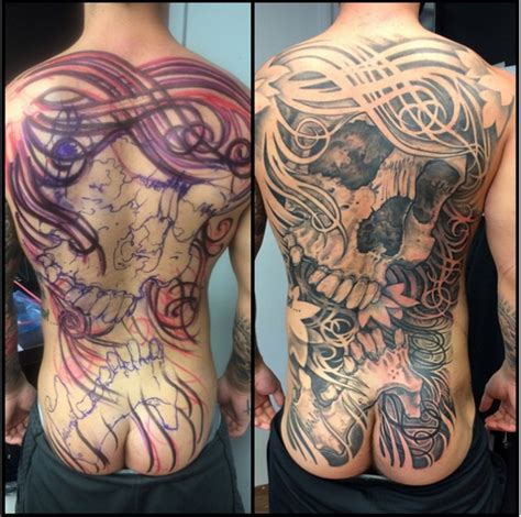 skull amp filigree backpiece rites of passage tattoo