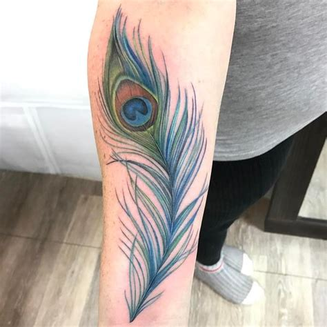 peacock feather tattoo 54 gorgeous peacock designs with meaning for everyone