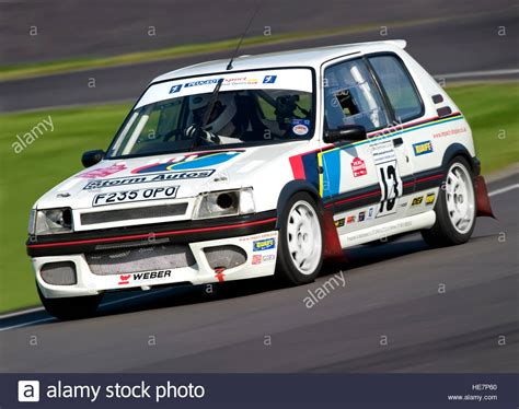 peugeot motor cars a peugeot 205 1 6 gti racing car at the castle combe motor