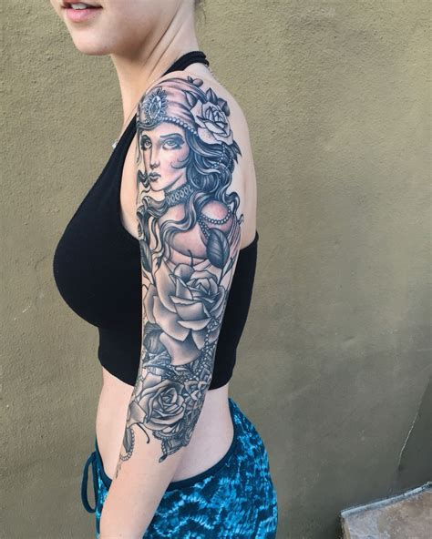 gypsy rose tattoo studio half sleeve with roses and mandala done by
