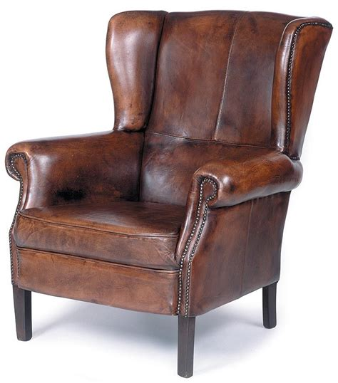 leather wing back chair traditional wing back leather chair w nailhead trim wood
