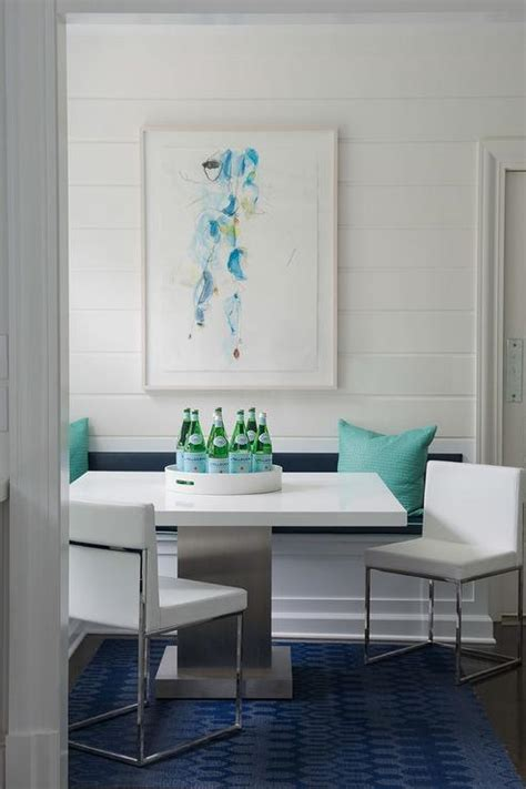 l shaped banquette turquoise and navy dining nook with built in banquette
