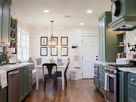 white shiplap  sage green cabinetry  country kitchen
