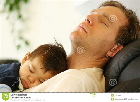sleeping with baby in recliner baby sleeping on dad s chest royalty free stock photo