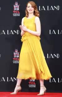 emma stone yellow dress beautiful celebrities wearing yellow outfits