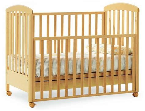 de la cuna a la altura de la cuna y de la cama padres