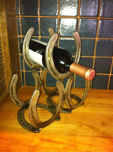 Wine Racks Made Out Of Horseshoes by 1000 Ideas About Horseshoe Wine Rack On