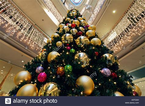 christmas tree decorated with big balls at the hall of a