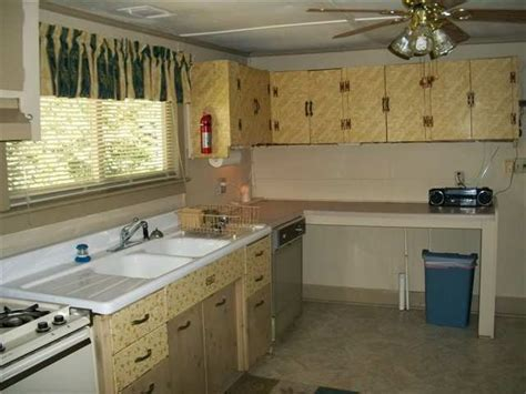 wallpaper on kitchen cabinets help these six kitchens ugly house photos