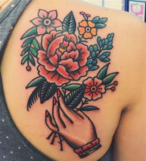 american traditional flower tattoo flowers done by joel janiszyn black anvil ft