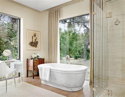 bathtub window bathtub in front of window transitional bathroom