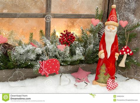 santa ckaus with snow decoration decoration with santa claus in a wooden window stock photo image 34902454