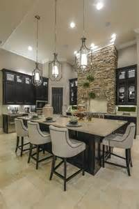 Kitchen Center Island Designs A Large Center Island Provides The Perfect Spot To Eat In