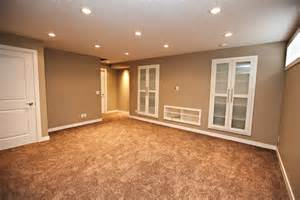 large basement space with minimalist themed using grey accents wall paint feat cool white solid