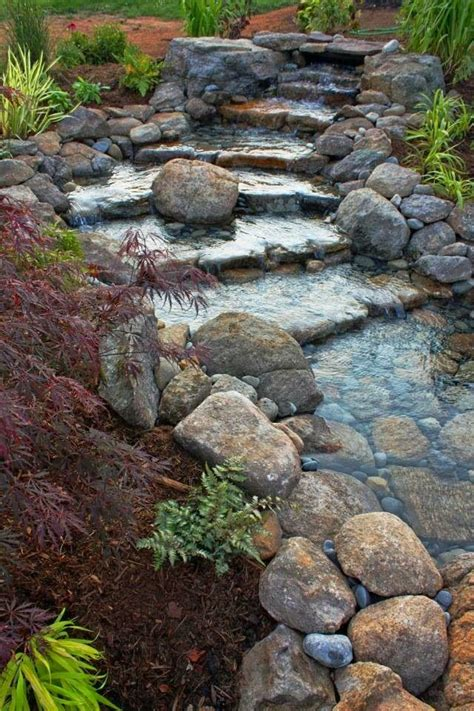 backyard waterfall designs 25 best ideas about river rock gardens on