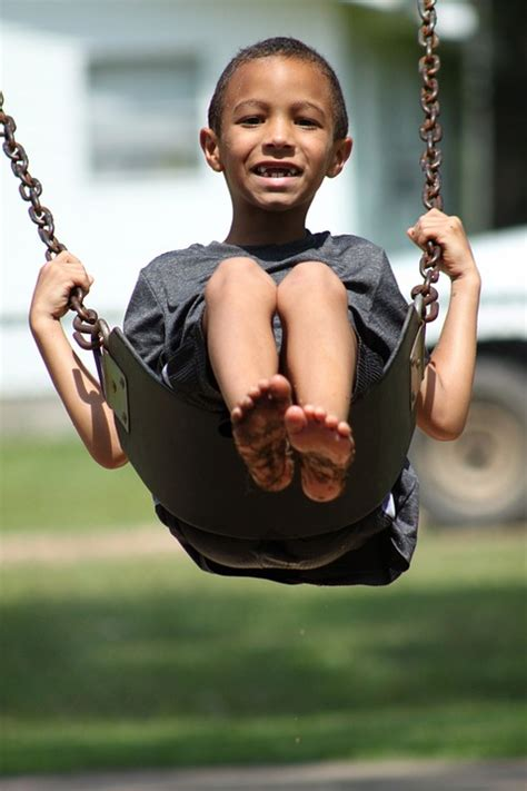 young swing free photo kid boy swinging young swing free image