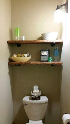 bathroom shelves behind toilet toilet shelves on pinterest toilet storage outhouse bathroom decor and outhouse