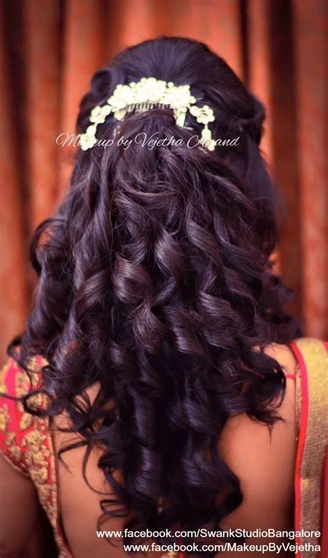 curls hairstyles on saree indian bride s reception hairstyle by vejetha for swank