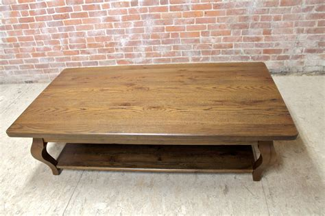 66in oak coffee table in antique walnut finish